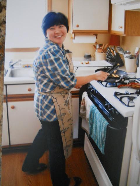 Rebecca making her famous egg rolls