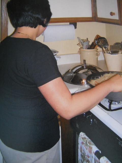 Rebecca frying her egg rolls