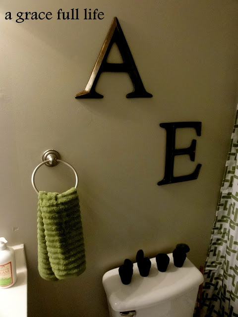 Towel bar gone. Now my girls initials are there.