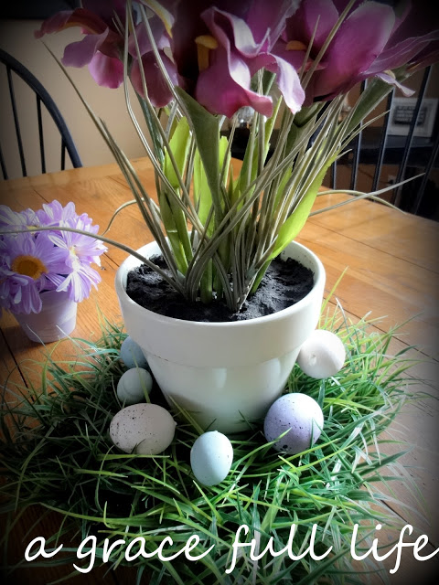 Add some old Easter eggs I have had and two little flowers I also got for the same baby shower at Michael's and voilà, I have my go to spring centerpiece.