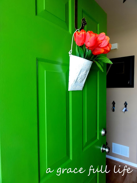 Flowers on green front door