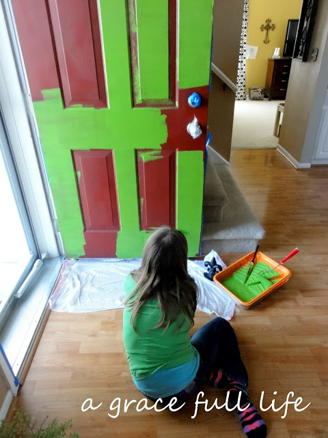 My tween helping paint our front door