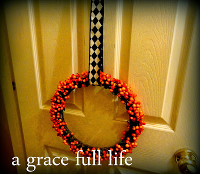 Orange berry wreath for Halloween