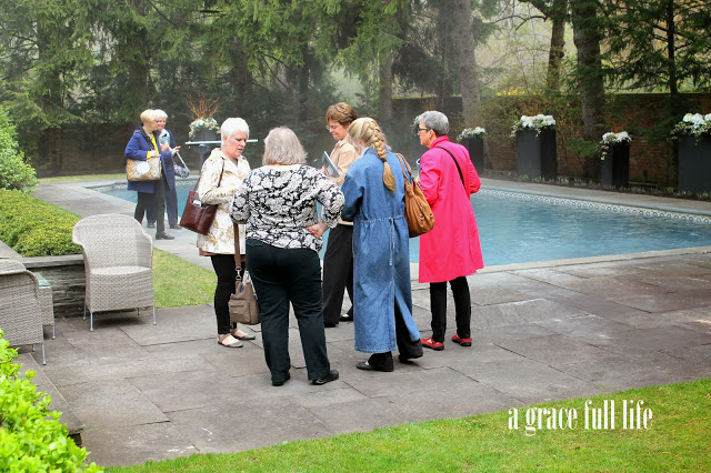 ladies chatting by John Hughes pool