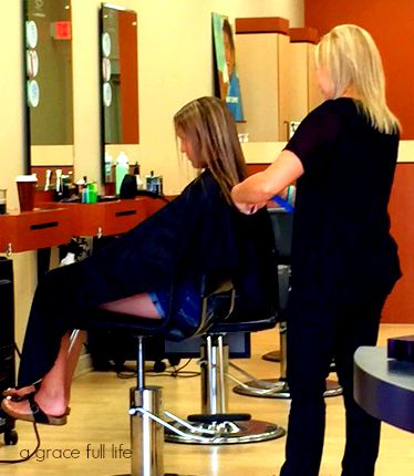 teenager getting hair cut