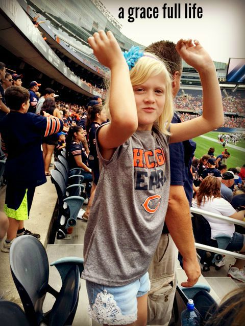 Ella cheering on the Chicago Bears