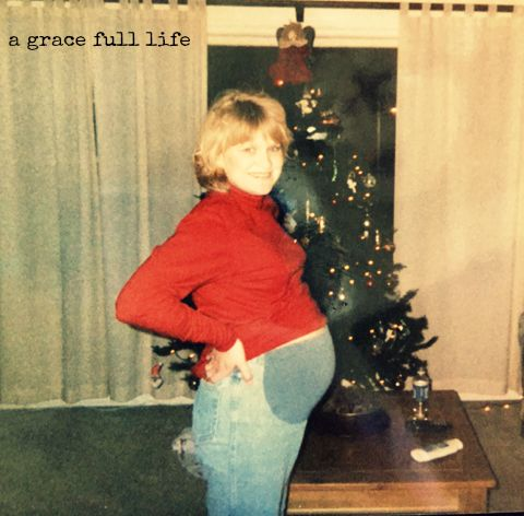 pregnant in front of christmas tree