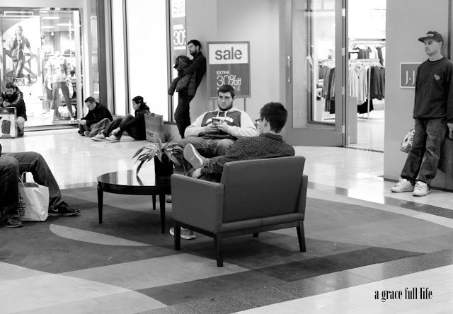Men waiting at Water Tower Place Chicago