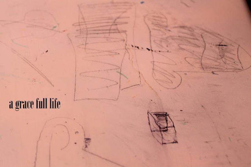 sketch marks on desk