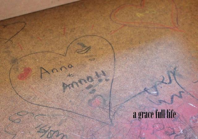 children's scribble marks in desk drawer