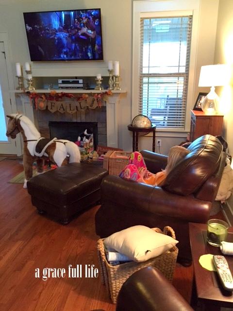 Ella watching tv at Mamie and Papa's