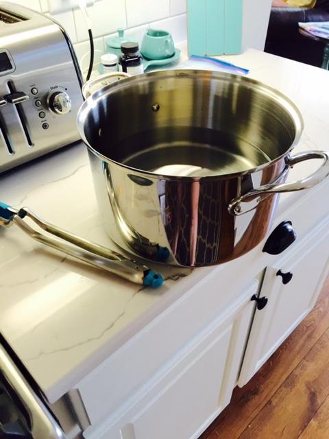metal pot and tongs