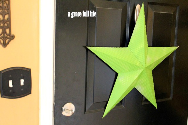 black front door green star