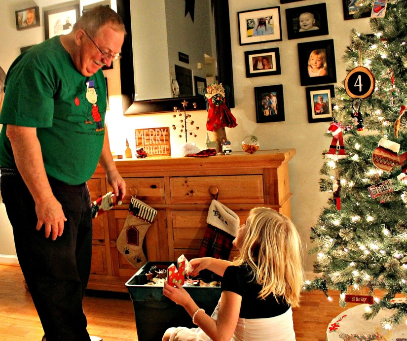 Papa and Ella decorating the tree.
