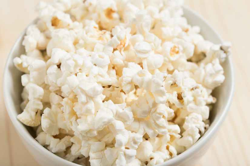 white popcorns on round white ceramic bowl